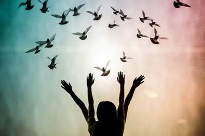 Image of birds clustered above a woman depicting Mindfulness regarding Heaven's Wait